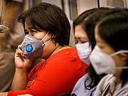 31 JANUARY 2019 - BANGKOK, THAILAND:   Commuters on the BTS Skytrain wearing breathing masks because of air pollution in Bangkok. The Thai government has closed more than 400 schools for the rest of the week because of high levels of pollution in Bangkok. At one point Wednesday, Bangkok had the third highest level of air pollution in the world, only Delhi, India and Lahore, Pakistan were worst. The Thai government has suspended some government construction projects and ordered other projects to take dust abatement measures. Bangkok authorities have also sprayed water into the air in especially polluted intersections to control dust. Bangkok's AQI (Air Quality Index) Thursday morning was 180, which is considered unhealthy for all people.   PHOTO BY JACK KURTZ