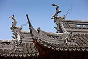 Roofs of the Happiness Tower decorated with Chinese dragons and fish, Yu Gardens, China