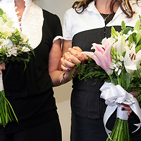 CeCe Pinhiero and Darlene Wilcox hold hands in their coordinated outfits as the women become legally married in a ceremony at the County Governement Center in Santa Cruz, California.<br /> Photo by Shmuel Thaler <br /> shmuel_thaler@yahoo.com www.shmuelthaler.com
