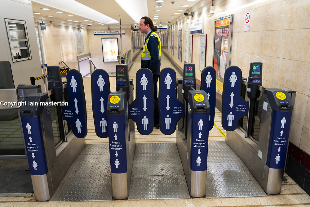 Glasgow, Scotland, UK. 20 June, 2020. Signs with social distance warnings to passengers on entrance barriers to Queen Street railway station in Glasgow.  Iain Masterton/Alamy Live News