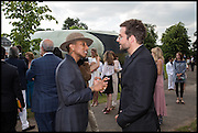 PHARRELL WILLIAMS; BRADELY COOPER, 2014 Serpentine's summer party sponsored by Brioni.with a pavilion designed this year by Chilean architect Smiljan Radic  Kensington Gdns. London. 1July 2014