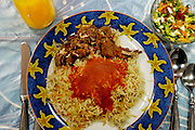 At their home in Kuwait City, Kuwait, most of the Al Haggan family dinners still center around traditional Arab foods like lamb biryani (shown here). Hungry Planet: What the World Eats (p. 200).