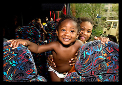 1st Sept, 2005. Mass evacuation of New Orleans begins. Faces of joy. A mother and child can not help but smile for joy as they boarde the first bus to evacuate New Orleans.