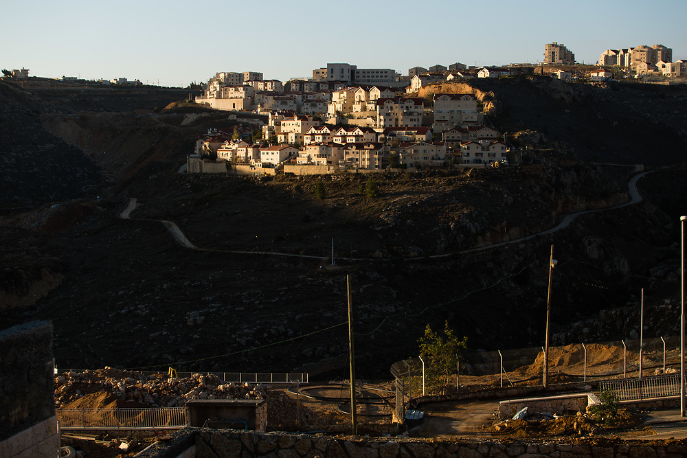 Houses at the West Bank Jewish settlement of Efrat in the Gush Etzion settlement bloc, are seen from a construction site in Givat HaDagan neighborhood, the northernmost neighborhood of Efrat which is situated on the southern outskirts of the Palestinian West Bank city of Bethlehem, on December 30, 2016.