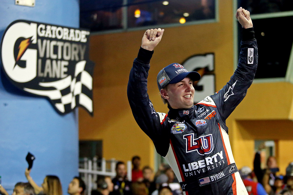 Nov 18, 2016; Homestead, FL, USA; NASCAR Camping World Truck Series driver William Byron (9) celebrates winning the Ford Ecoboost 200 at Homestead-Miami Speedway. Mandatory Credit: Peter Casey-USA TODAY Sports