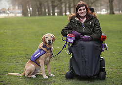 Clare Syvertsen, 29, from Notholt in London, with her Labrador/Golden Retriever cross Griffin, during a photocall by The Kennel Club in Green Park, London, to announce the finalists for the Crufts dog hero competition, Friends for Life 2018.
