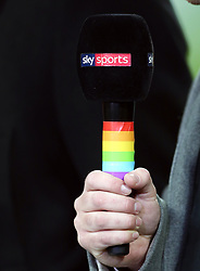 A Sky Sports microphone with a rainbow coloured handle, in association with Stonewall