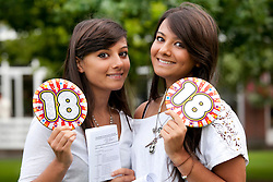© Licensed to London News Pictures.16/08/2012. Solihull, West Midlands. Pupils at Solihull School celebrating their A level results. Pictured, Twins, Hanah, left,  Lara, right, Jesani, who both celebrated their 18th birthday today with 5, A's, A levels between them. Both girls, whose father is a heart surgeon will follow in the family traddition and go to to Cardiff University to study Medical Science. Photo credit : Dave Warren/LNP