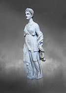 Statue of Artemis, found at the 'House of Diadoumenos' on Delos. Pariam marble, Circa 100 BC. Athens Archaeological Museum, Cat No 1829. Against grey<br /> <br /> Artemis wears a chiton, a girt and himation. The diagonal strap ocross her breast will have held the quiver full of arrows. The Goddess's beauty is stressed by her elaborate coiffure. .<br /> <br /> If you prefer to buy from our ALAMY STOCK LIBRARY page at https://www.alamy.com/portfolio/paul-williams-funkystock/greco-roman-sculptures.html . Type -    Athens    - into LOWER SEARCH WITHIN GALLERY box - Refine search by adding a subject, place, background colour, etc.<br /> <br /> Visit our ROMAN WORLD PHOTO COLLECTIONS for more photos to download or buy as wall art prints https://funkystock.photoshelter.com/gallery-collection/The-Romans-Art-Artefacts-Antiquities-Historic-Sites-Pictures-Images/C0000r2uLJJo9_s0