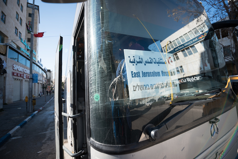 27 February 2020, Jerusalem: People get on the bus in Hebron, as the Augusta Victoria Hospital in Jerusalem offers a special bus service in an effort to faciliate access to medical services for patients living in the West Bank.