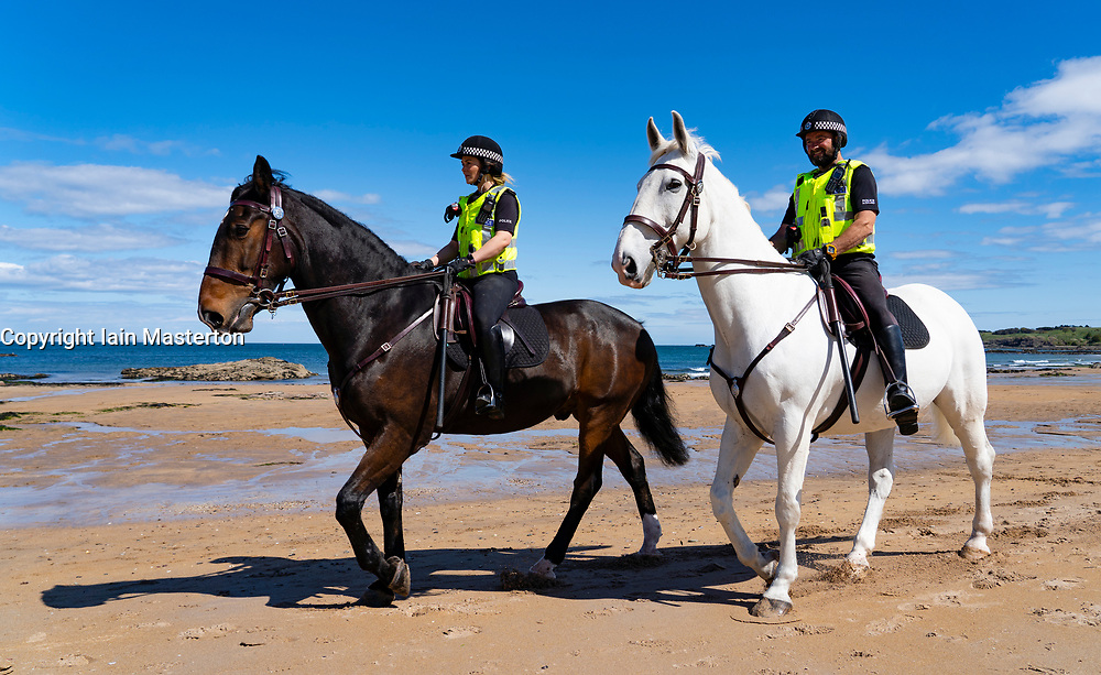 North Berwick, Scotland, UK. 26 April 2020. Mounted police patrolling the beaches of North Berwick in East Lothian this afternoon. Horses Inverness (dark) and Edinburgh travelled from their stables in Stewarton in Ayrshire for today's walk. However the beaches were very quiet and the horses' main duty was to pose for photographs with the few people outdoors.  Iain Masterton/Alamy Live News