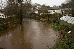 © Licensed to London News Pictures. 22/12/2012. Helston, UK. View of the River Cober that has burs its banks over night after heavy rain across the South West. The Environment Agency issued a Severe flood warning for the River Cober. Photo credit : Ashley Hugo/LNP