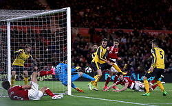 Arsenal goalkeeper Petr Cech saves from close range from Middlesbrough's Daniel Ayala
