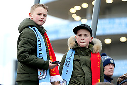 Young Manchester City fans outside the stadium before the match begins