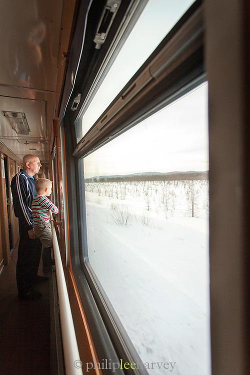 Passengers on the BAM (Baikal-Amur Mainline) railway, outskirts of Tynda, Siberia, Russia