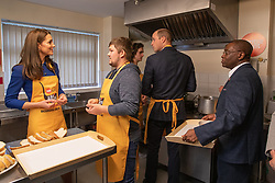 The Duke and Duchess of Cambridge help to prepare soup and bread with Clare Blampied, during a visit to Centrepoint in Barnsley.