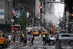 Barricades, sanitation trucks and are set up in front of and around Trump Tower during President Donald Trump's first stay in New York City since taking office, New York, NY, on August 15, 2017. (Photo by Anthony Behar)