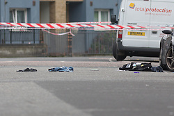 © Licensed to London News Pictures. 15/10/2015. London, UK. Items of clothing and personal effects at the scene of a shooting in Haggerston, Hackney on the corner of Lovelace Street and Haggerston Road. Photo credit : Vickie Flores/LNP