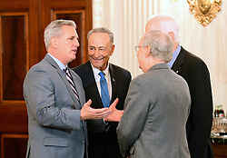 United States House Majority Leader Kevin McCarthy (Republican of California), left, engages in conversation with US Senate Minority Leader Chuck Schumer (Democrat of New York), left center, and US Senate Majority Leader Mitch McConnell (Republican of Kentucky), right center, and US Senate Majority Whip John Cornyn (Republican of Texas), right, looks on prior to the arrival of President Donald Trump at a reception for US House and US Senate Republican and Democratic leaders in the State Dining Room of the White House in Washington, DC, USA, on Monday, January 23, 2017. Photo by Ron Sachs/CNP/ABACAPRESS.COM