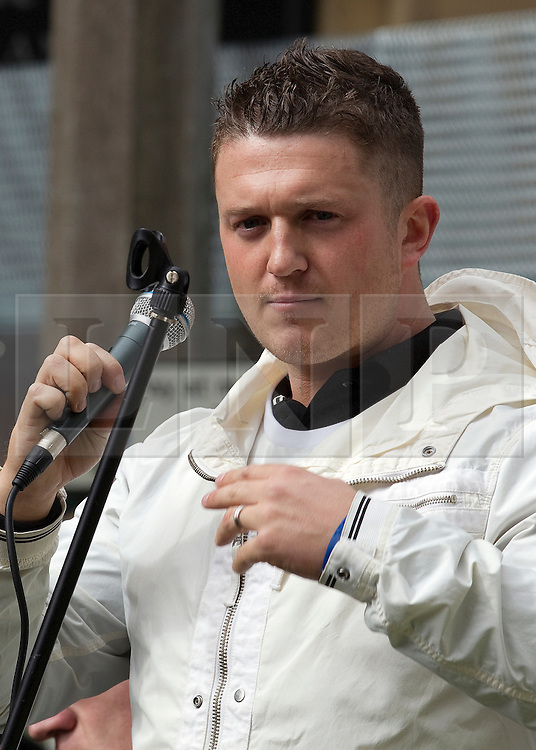 """© under license to London News Pictures. 02/04/2011: EDL leader Stephen Lennon (aka Tommy Robinson) addresses a rally in Blackburn. Prior to the rally, the EDL leader has stated that he's been warned off attending the rally by police, for his own safety. About 2000 EDL supporters were in attendance. It was one of the largest policing operations Lancashire police have ever put in to action. Credit should read """"Joel Goodman/London News Pictures""""."""