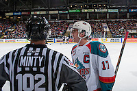 KELOWNA, CANADA - FEBRUARY 10: Linesman Dustin Minty stands at centre ice as Rodney Southam #17 of the Kelowna Rockets trash talks the Vancouver Giants' bench on February 10, 2017 at Prospera Place in Kelowna, British Columbia, Canada.  (Photo by Marissa Baecker/Shoot the Breeze)  *** Local Caption ***