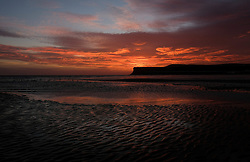 © Licensed to London News Pictures. <br /> 28/09/2016. <br /> Saltburn-by-the-Sea, UK.  <br /> <br /> Clouds over Saltburn by the Sea turn a dramatic orange as the sun begins to rise over the beach and cliffs.<br /> <br /> Photo credit: Ian Forsyth/LNP
