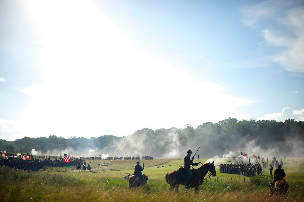 Union and Confederate troops stage the battle of the wheat field on the second of a four day Gettysburg Anniversary Committee 150th Gettysburg reenactment in Gettysburg, PA on July 5, 2013.