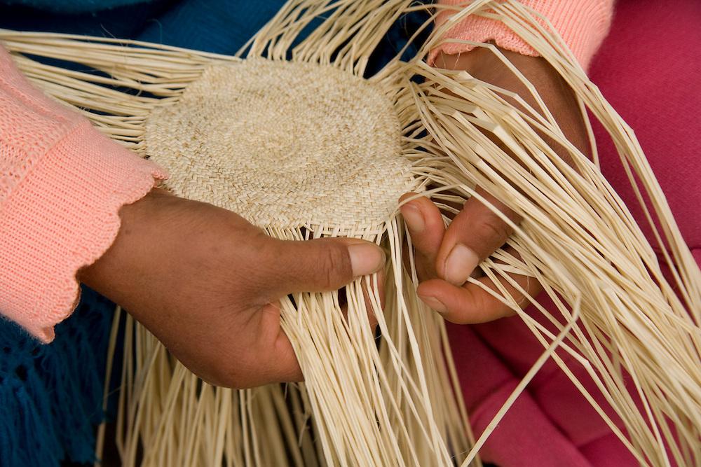 Hands weaving traditional Panama Hat of toquilla straw, Chordeleg (near Cuenca), Ecuador, South America