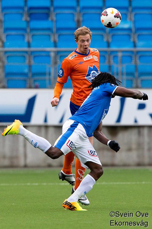 Treningskamp fotball 2014: Molde - Aalesund. Aalesunds  Peter Orry Larsen (bak) i hodeduell med Daniel Chima Chukwu i treningskampen mellom Molde og Aalesund på Aker stadion.