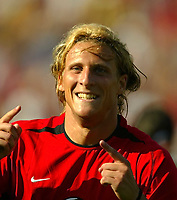 Photo Aidan Ellis.<br />Manchester United v Club America. (at The Coliseum Stadium in Los Angeles). 27/07/03.<br />United's Diego Forlan celebrates his goal and United's 2nd