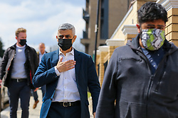 © Licensed to London News Pictures. 30/04/2021. London, UK. Sadiq Khan, Mayor of London, wearing a face covering arrives at the London Islamic Cultural Society and Mosque, also known as Wightman Road Mosque in Haringey, north London to join muslim devotees for Friday prayers during the Islamic holy month of Ramadan. The Mayor of London and the devotees are two meters apart and keeping to the rules of social distancing. Muslims across the world are observing the holy fasting month of Ramadan, a month long celebration with prayers, readings from the Koran and meeting with family and friends, as they abstain from eating, drinking and smoking from dawn till dusk. Sadiq Khan is running for re-election as London Mayor. Photo credit: Dinendra Haria/LNP