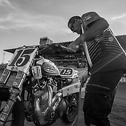 Mark Cheza, Nicole Mees' father, readies one of her two Harley Davidson race bikes before the Sacramento Mile.
