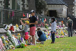 March 16, 2019 - Christchurch, New Zealand - Flowers and message besides the Botanic Gardens, Rolleston Avenue after shooting incidents at the Linwood Islamic Centre, Linwood Avenue and the Mosque in Deans Avenue , Christchurch, New Zealand, March 16, 2019. (Credit Image: © David Alexander/SNPA/ZUMAPRESS.com)