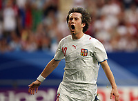 Photo: Chris Ratcliffe.<br /> USA v Czech Republic. Group E, FIFA World Cup 2006. 12/06/2006.<br /> Tomas Rosicky of the Czech Republic celebrates his second and the Czech Republic's third goal.