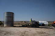 CB Barton, normally a computer network administrator, now volunteers with Water Warriors to deliver water to families in remote parts of the Navajo, Nation near Gallup, New Mexico. Here, he fills a 1,000 gallon tank from a safe-to-use well in Coyote Canyon.
