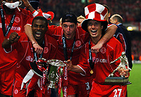 (RIGHT TO LEFT) BOLO ZENDEN/FRANCK QUEUDRUE AND GEORGE BOATENG MIDDLESBROUGH CELEBRATE WITH CUP<br /> MIDDLESBROUGH V BOLTON WANDERERS <br /> CARLING CUP FINAL 29/02/04<br /> PHOTO ROBIN PARKER FOTOSPORTS INTERNATIONAL