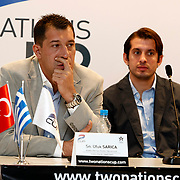 Anadolu Efes's head coach Ufuk SARICA and Kerem TUNCERI (R) seen during their Two Nations Cup Press Conference press conference at Anadolu Efes sports hall in Istanbul Turkey on Friday 30 September 2011. Photo by TURKPIX