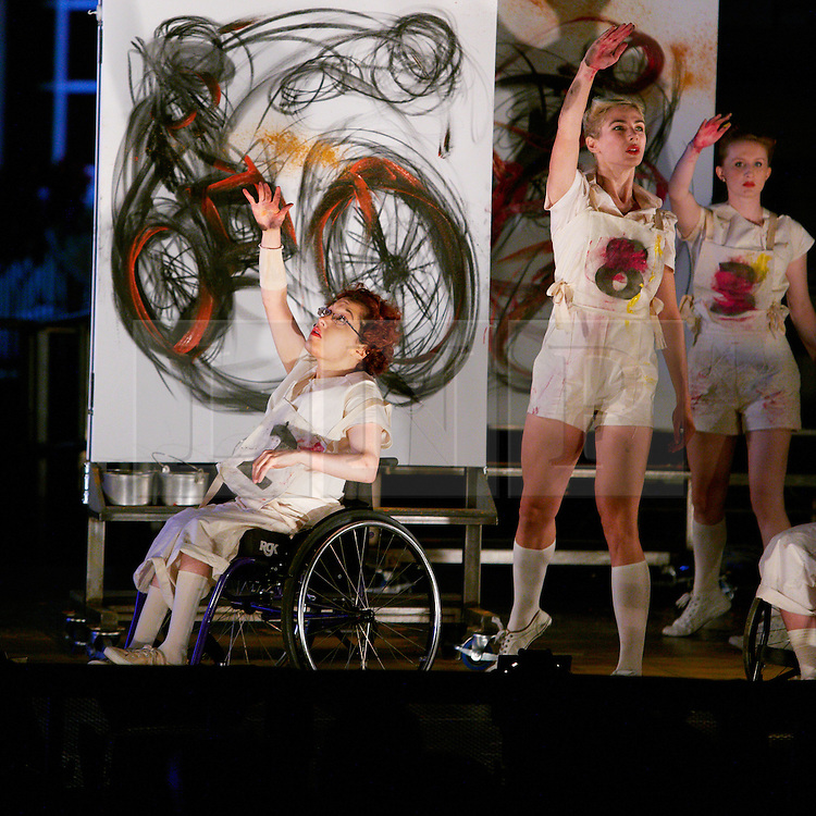 © Licensed to London News Pictures.  28/08/2012. AYLESBURY, UK. Dance troupe Starting Line, which includes both able bodied and disabled dancers perform during a paralympic flame celebration in Aylesbury town centre. Nearby Stoke Mandeville is the birthplace of the paralympics and a 24 hour torch relay began at 8pm this evening (Tuesday) and will finish in the Olympic Park in Stratford tomorrow. Photo credit :  Cliff Hide/LNP