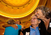 Mark Guzman, (Center facing camera) of El Dorado Hills is hugged with joy and Shelly Bailes, (second from right)  and Ellen Pontac (far right) of Davis celebrate inside the rotunda the State Assembly's passing of the gay marriage bill, AB 849 by Mark Leno D-San Francisco, Tuesday Sept. 6, 2005. The senate passed the bill last week and will now go to the Governor Arnold Schwarzenegger's desk to be signed into law or vetoed. The two have been together for 31 years.