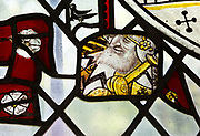 Saint Nicholas chapel, Gipping, Suffolk, England, UK medieval stained glass of east window jovial bearded man