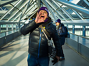 28 FEBRUARY 2020 - MINNEAPOLIS, MINNESOTA: A union leader leads a chant during a picket by striking members of the SEIU Local 26 at the Minneapolis St. Paul International Airport. About 4,000 janitorial and custodial workers represented by the Service Employees International Union (SEIU) Local 26 in the Twin Cities are on an Unfair Labor Practices (ULP) strike for better wages and benefits. Friday morning they picketed  the Minneapolis-St. Paul International Airport Friday morning.         PHOTO BY JACK KURTZ
