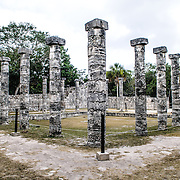 Rows of stone pillars line the Plaza of the Thousand Columns at Chichen Itza Mayan ruins archeological zone in the heart of Mexico's Yucatan Peninsula.