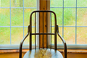 Wooden chair, sunroom during a rain storm, October, vacation house, Cheshire County, New Hampshire, USA