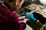 Polishing a cloisonne vase. Ando Cloisonne, Nagoya, Aichi Prefecture, Japan, February 26, 2018. Family-owned and run Ando Cloisonne was founded in the 1880s and is the only large manufacturer of cloisonne metalware left in Japan. The cloisonne enamelling process is technologically complex and a single work may feature over 50 colours.