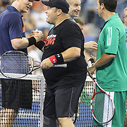 Players shake hands after the exhibition tennis double match between John McEnroe and Adam Sandler and Jim Courier and Kevin James during the US Open Tennis Tournament, Flushing, New York. USA. 5th September 2012. Photo Tim Clayton
