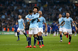 Manchester City's Raheem Sterling (centre) celebrates with his team mates after winning the Carabao Cup Final at Wembley Stadium, London.