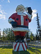 "The world's largest Santa Claus statue greets visitors to Santa Claus House in the Christmas themed town of North Pole (14 miles east of Fairbanks), Alaska, USA. Standing 42 feet high and weighing 900 pounds, this Santa was built for the 1962 World's Fair in Seattle, and then travelled promotionally until emplaced at North Pole in 1983. Saint Nicholas was born in Patara on the Aegean Sea coast of Anatolia (Asia Minor). As a Byzantine Christian bishop, Nicholas of Myra anonymously dropped gifts of coins down the chimneys of village girls who lacked dowries, thereby allowing them to marry and probably avoid a life of prostitution. After his death he was declared Saint Nicholas, patron saint of virgins, sailors, children, pawnbrokers, Holy Russia, and others. Saint Nicholas' town of Myra is now called Demre in the Republic of Turkey. The fame of Saint Nicholas grew in different cultures, such as in the Dutch figure of ""Sancte Claus,"" and in the German legend of Christkindl (the Christ child) who was helped by the elf Belsnickle, imitated by adults in furs who brought gifts. These traditions evolved into Kris Kringle, as defined by Reverend Clement Moore in the famous 1822 poem ""A Visit From St. Nicholas"" which starts: "" 'Twas the night before Christmas when all through the house / Not a creature was stirring not even a mouse... ."" In the Civil War era of the United States of America, Thomas Nast further solidified the image of Kris Kringle in Harper's Magazine illustrations of a familiar white-bearded, gleaming-eyed man. Today in Turkey, Saint Nicholas is known as ""Noel Baba"", or Father Christmas."