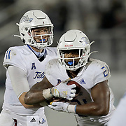 ORLANDO, FL - OCTOBER 03: T.K. Wilkerson #21 of the Tulsa Golden Hurricane takes a handoff from quarterback Zach Smith #11 of the Tulsa Golden Hurricane against the Central Florida Knights at Bright House Networks Stadium on October 3, 2020 in Orlando, Florida. (Photo by Alex Menendez/Getty Images) *** Local Caption *** T.K. Wilkerson; Zach Smith