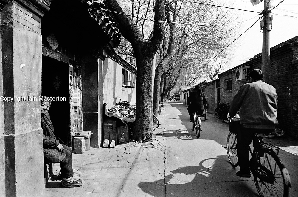 View of busy hutong in Beijing prior to being demolished and redeveloped