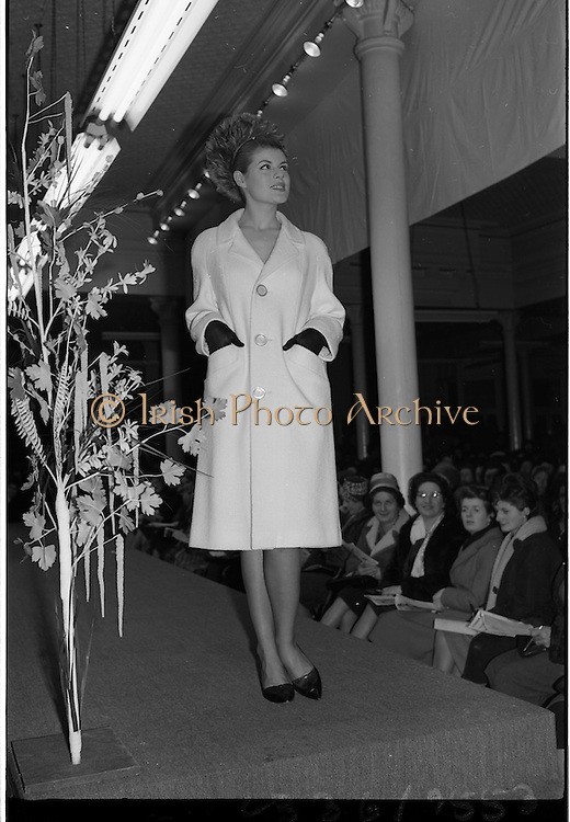 09/03/1964<br /> 03/09/1964<br /> 09 March 1964<br /> McBirney's Fashion show at McBirney's, Aston Quay, Dublin. Image shows model Carol, wearing a white coat.